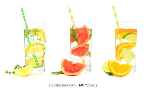 Variety of citrus infused detox water drinks in glasses with paper straws isolated on a white background