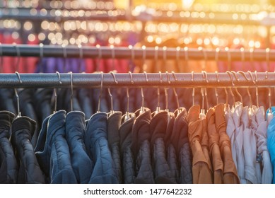 a variety of clothes offered for sale by street vendors