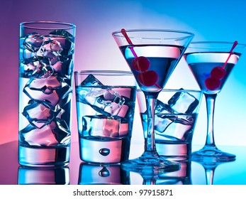 Variety of cocktails on pink and blue background