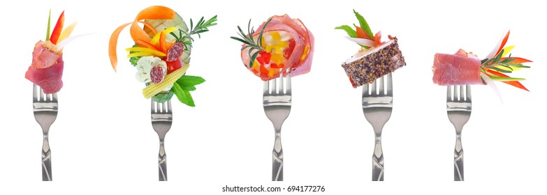 Variety of cold cuts appetizers on forks - white background