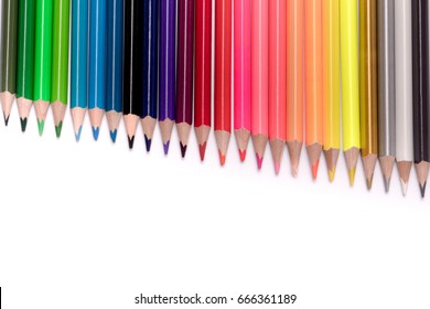 variety of color pencils on white background