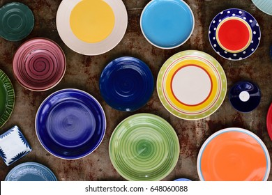 A variety of color plates and bowls on background