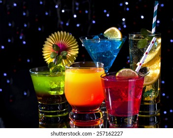 Variety of colorful cocktails over starry black background