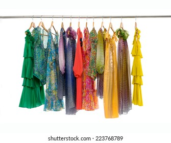 Variety of colorful fashion female clothing on hanging
