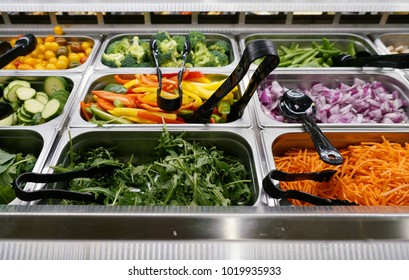 variety of colorful fresh vegetable in container in restaurant