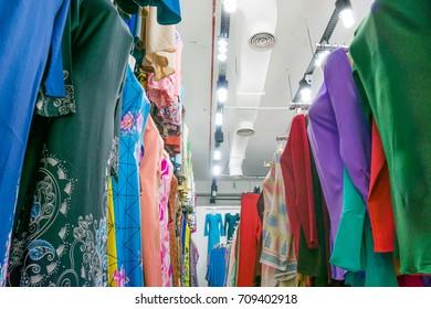 Variety and colorful of Malaysian traditional baju kurung display at shop