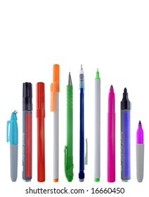A variety of colorful pens in line, with and without their caps. Isolated on white.