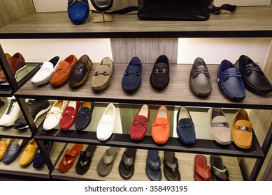 Variety colorful slip-ons or drivers shoes and sandals on the shelf in the menâ??s fashion footwear and accessories shop in Singapore. Casual, fashion and work shoes for men.