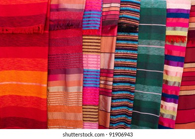 Variety of colorful stripy  covers on market in Morocco