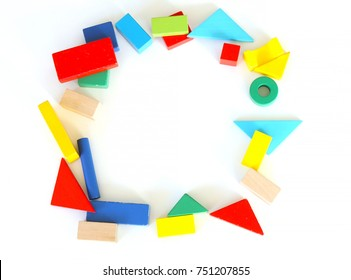 Variety of colorful toy blocks on white background, flat lay.