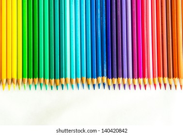Variety of colour pencils on white background