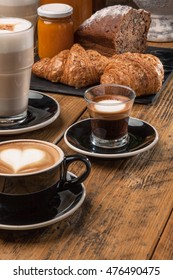 Variety Of Cups Of Coffee On Old Wooden