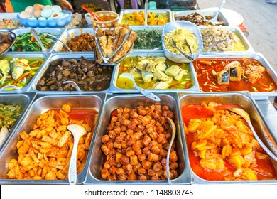 Variety of delicious Malaysian food being sold at street food stall in Kota Kinabalu, Sabah, Malaysia.