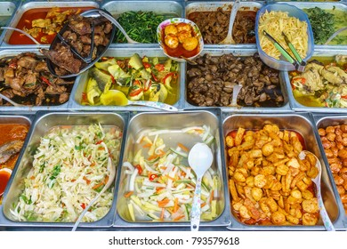 Variety of delicious Malaysian home cooked dishes sold at street market stall in Kota Kinabalu Sabah