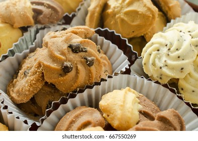 Variety of different kinds of sweet cookies with chocolate chip cookies