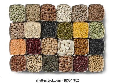 Variety of dried beans and lentils in bags on white background