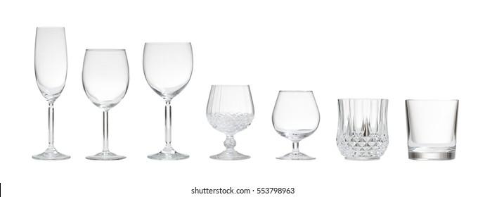 Variety of empty crystal glasses on white background