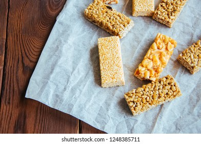 Variety of energy bars with nuts on a baking paper. Healthy snac