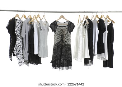 Variety of female casual fashion clothing hanging on hangers