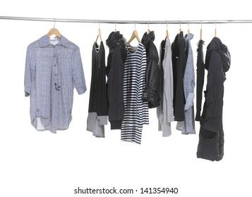 Variety of female fashion clothing hanging on hangers