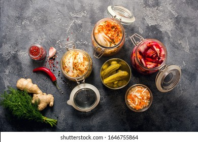Variety of fermented vegetables, kimchi in glas jars, marinated canned food, natural probiotics, healthy eating, prebiotic rich food for digestion and healthy gut, immunity boost, food processing