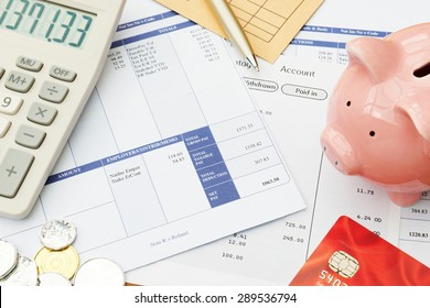 Variety Of Financial Objects Arranged On Wage Slip