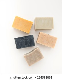 Variety of Five Artisan Organic Soaps on White Background