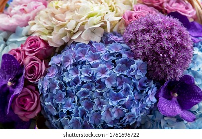 Variety of flowers bouquet such as  hydrangea, rose, orchids as many more, colorful background.