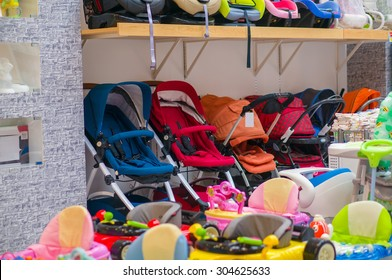 Variety of folding baby carriages in kids mall