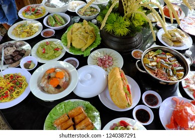 Variety of food on party table, group of Vietnamese food model imitation from Vietnam cuisine make by plastic, colorful of popular food with noodle, vegetables, soup, roll from high view