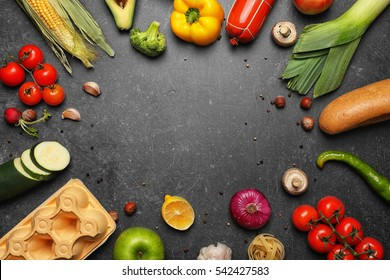 Variety of food products on grey background