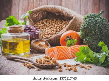 Variety of food vegetables with nut and salmon
