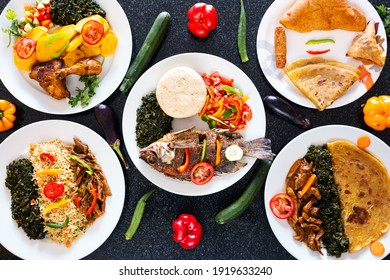 Variety of foods, potatoes, Ugali and fish, Chapati and beef stew, sausage and andazi and samosa
