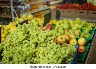Variety of fresh ripe fruits in supermarket