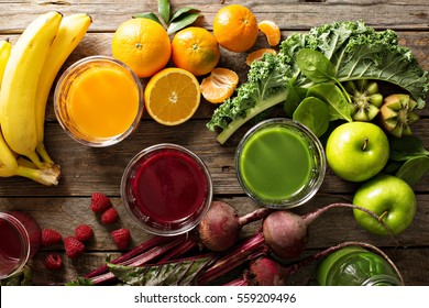 Variety of fresh vegetable and fruit juices in glasses overhead shot