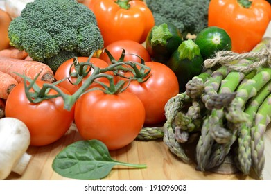 Variety of fresh vegetable on a wooden table