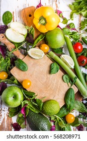 Variety of fresh vegetables and fruits on a wooden table