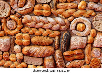 Variety of fresh yummy bread resting on wood