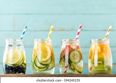 Variety of fruit infused detox water in jars for a healthy diet eating