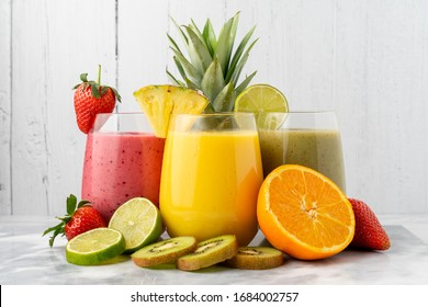 Variety of fruit smoothies, with their ingredients.
