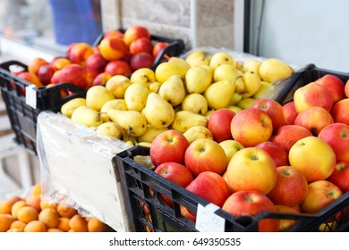 Variety of fruits in boxes on the grocery market