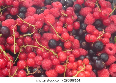 a variety of fruits in the form of currants, raspberries
