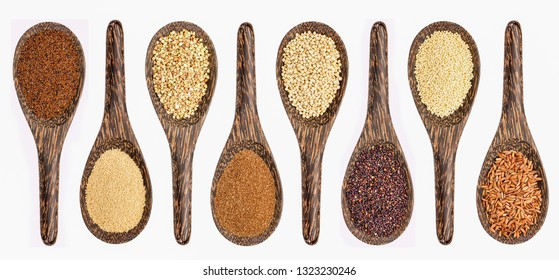 variety of gluten free grains (from left: kaniwa,  amaranth,  buckwheat, teff, sorghum, black quinoa,  millet, and brown rice) - set of wooden spoons isolated on white