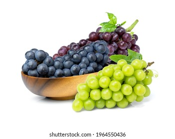 Variety of grapes ;  purple, black and green grape isolated on white background.