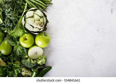 Variety of green vegetables and fruits copyspace on white