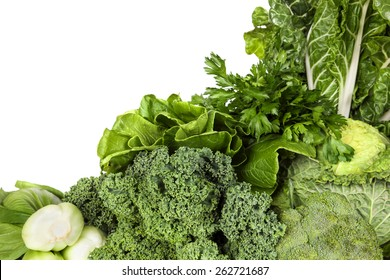 Variety of green vegetables, over white background.