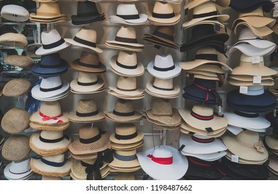 Variety of hats for sale in the market.