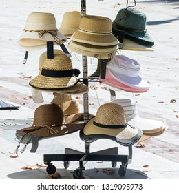 Variety of hats for sale on a spanish street in Sevilla. Fashionable 13af447971d