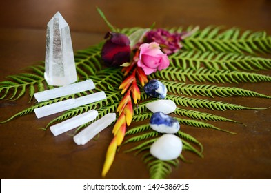 Variety of Healing Crystals on wood table. Witchy crystal set up, alter of crystals Bohemian decorations, rainbow crystals. Quartz tower, Selenite, sodalite, Clear Quartz. Meditation Grid Kit