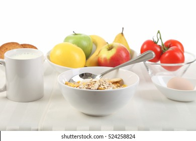 A variety of healthy foods served at the table in front of a white background